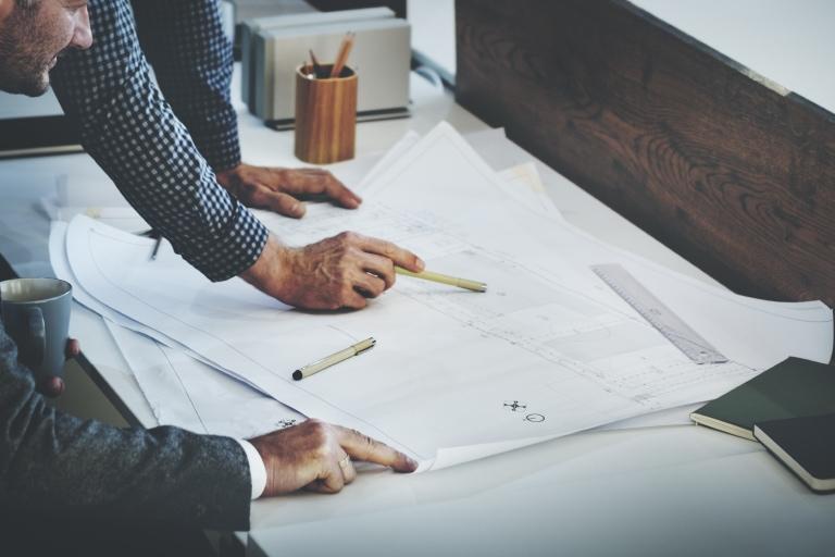 General contractors reviewing building plans