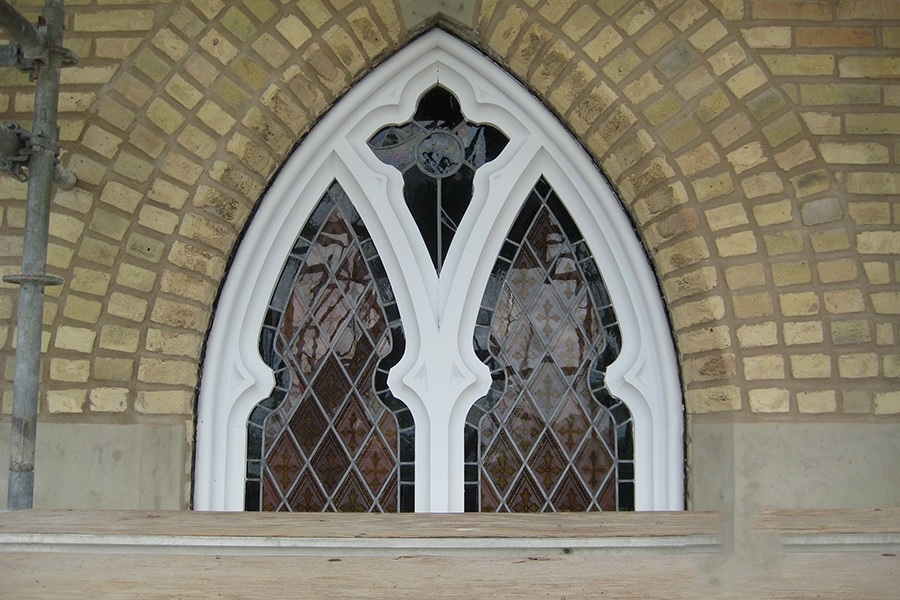 Our Lady of Mercy Church side view of window restoration project Archway window restoration close up