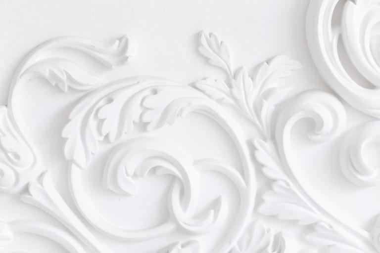 Detailed plaster restoration on a ceiling