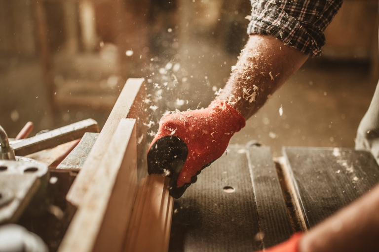 A man using a table saw for woodworking